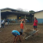 Children clearing the meeting site
